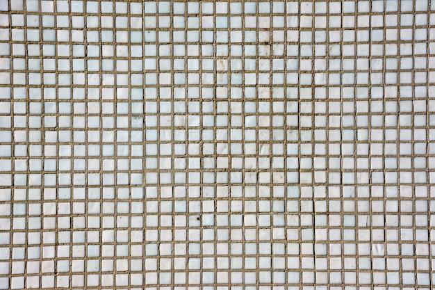Nahtlose weiße quadratische fliesen textur. weiße mosaikfliesen abstrakten hintergrund und textur.