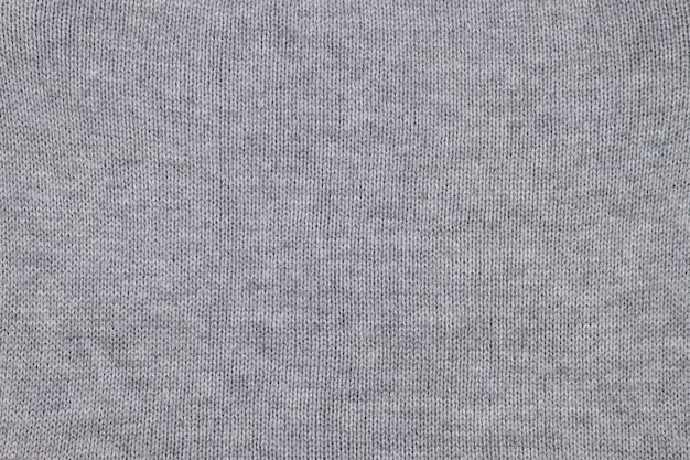 Nahtloser grauer strickstofftexturhintergrund.