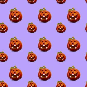 Nahtloser hintergrund mit einem muster von kürbissen. halloween-konzept.