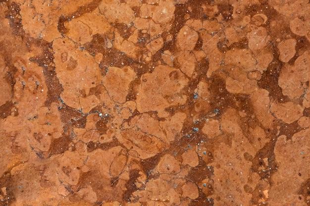 Nahtloser rissiger marmor beschädigte die betonstruktur.