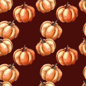 Nahtloses aquarellmuster mit einem orange kürbis auf dunklem hintergrund, aquarellillustration mit gemüse