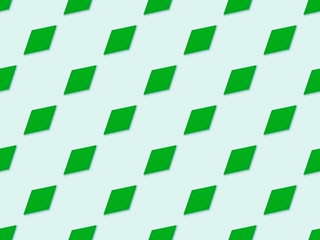 Nahtloses geometrisches muster der grünen raute auf blauem hintergrund. abstraktes musterdesign mit minimalistischer geometrie