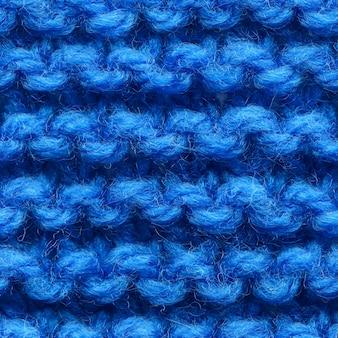 Nahtloses muster aus dunkelblauem strickstoff für randlose füllung. wiederholtes strickmuster
