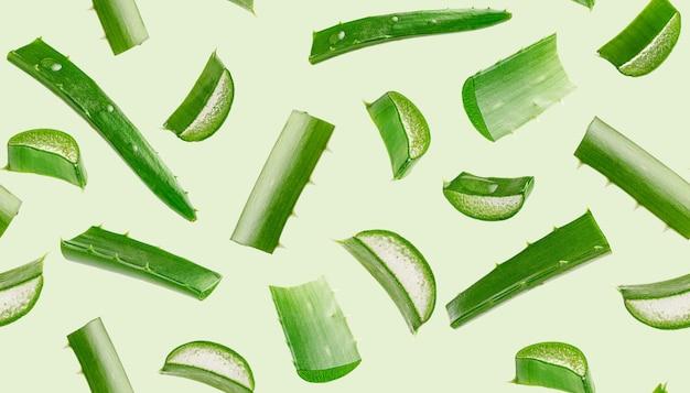 Nahtloses muster der aloe vera auf grünem hintergrund. körperpflege
