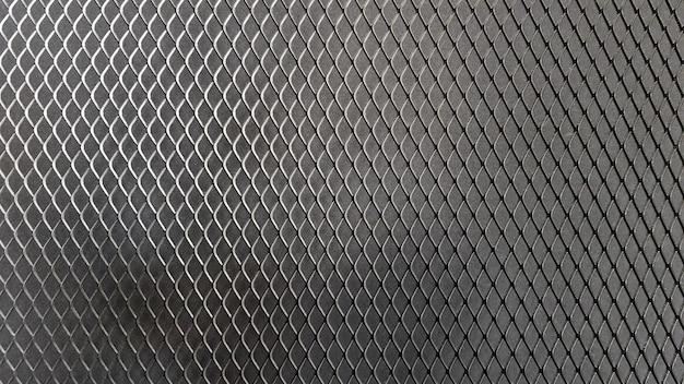 Nahtloses muster der metallmasche. schwarze metallgitterstruktur auf schwarzem hintergrund. schwarzes brett für text- und nachrichtendesign. rautenform.