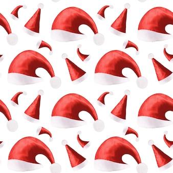 Nahtloses muster der roten weihnachtsmützen lokalisiert auf einem weißen hintergrund. foto in hoher qualität