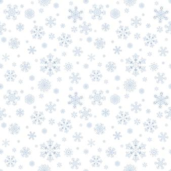 Nahtloses muster des abstrakten winters mit blauen schneeflocken auf weißem hintergrund konzept guten rutsch ins neue jahr und frohe weihnachten
