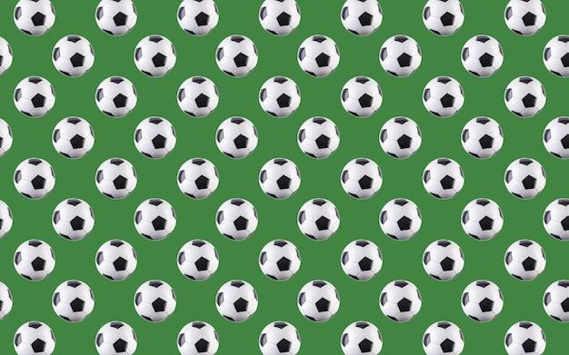 Nahtloses muster von kugeln. schwarze und weiße fußbälle, die in die luft fliegen, isoliert auf grünem hintergrund. minimalistisches sportkonzept