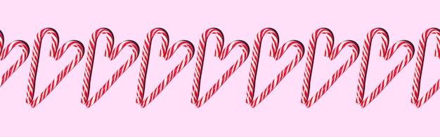 Nahtloses musterband rote und weiße weihnachtsbonbonstäbe in form eines herzens