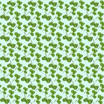 Nahtloses regelmäßiges kreatives muster mit grünen zweigen mit espenblättern