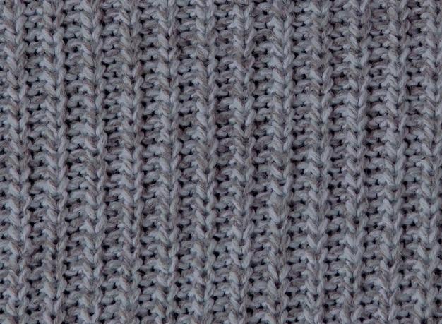Nahtloses strickmuster. grauer wollhintergrund. alte handgemachte strickware