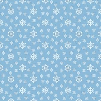 Nahtloses weihnachtsmuster mit schneeflocken auf pastellblauer oberfläche