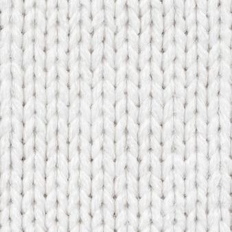 Nahtloses weißes strickmuster für randlose füllung. wiederholtes strickmuster