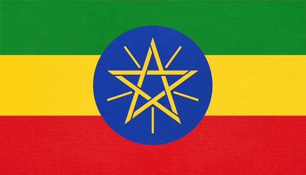 Nationale gewebeflagge der republik äthiopien, textilhintergrund. symbol des afrikanischen weltlandes.