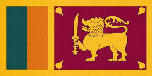 Nationale gewebeflagge der republik sri lanka, textilhintergrund. symbol des asiatischen weltlandes.