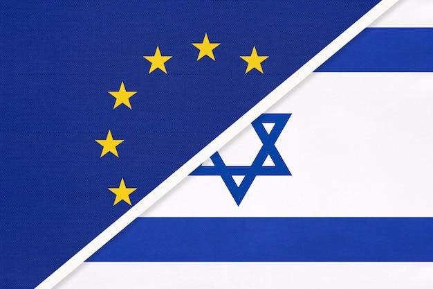 Nationalflagge der europäischen union oder der eu und des staates israel aus textil.