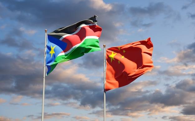 Nationalstaatsflaggen des südsudan und chinas zusammen