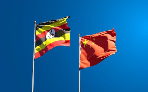 Nationalstaatsflaggen von uganda und china zusammen