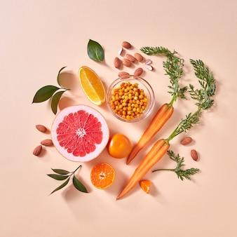 Natürliche bio-zitrusfrüchte, karotten, sanddornbeeren - zutaten für die hausgemachte herstellung