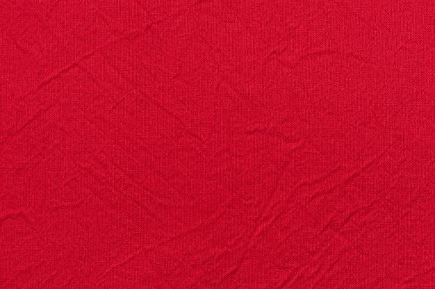 Natürliche leinenstruktur für den hintergrund ist rot.