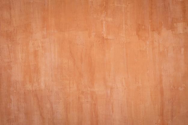 Natürliche wandhintergrundbeschaffenheit des roten lehms.