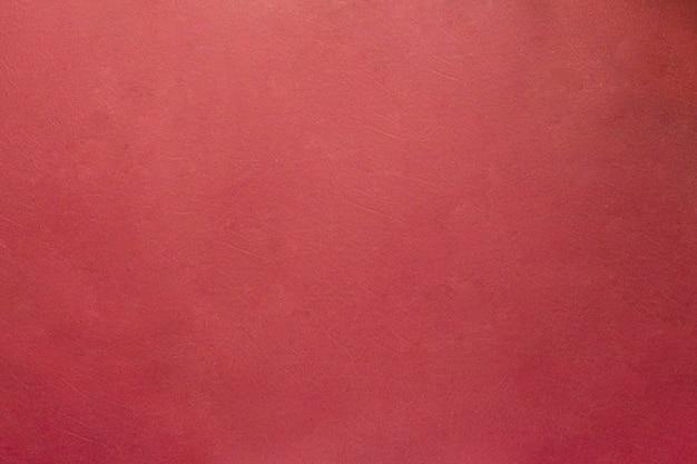 Natürlicher burgunderfarbener lederhintergrund alter schäbiger texturweinlese