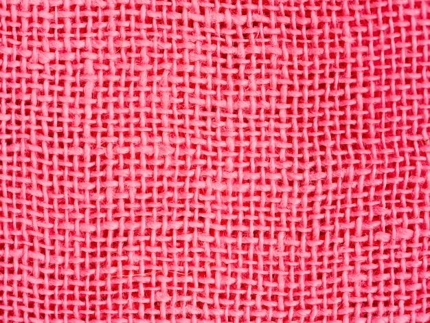Natürlicher rosa baumwollstoff, der nahaufnahme als hintergrundtextur webt