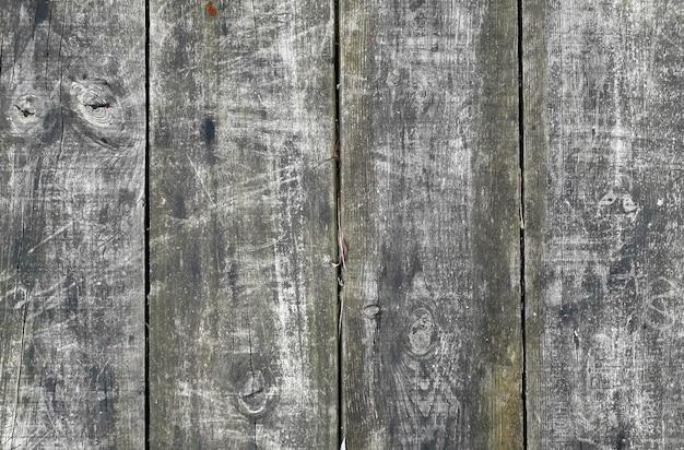 Natürlicher und rustikaler hintergrund mit vier grauen lamellen