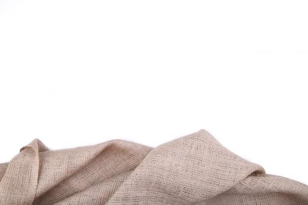 Natürliches sackleinen lokalisiert auf weißem, lokalisiertem segeltuch