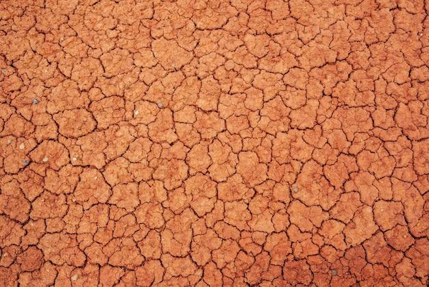 Natur rissiger trockener gebiete natürliche bodentextur