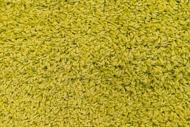 Naturgras textur gemusterter hintergrund in golfplatzrasen aus der draufsicht: abstrakter hintergrund des authentischen grasbewachsenen, strukturierten musterhintergrundes in hellgelbgrünem farbton