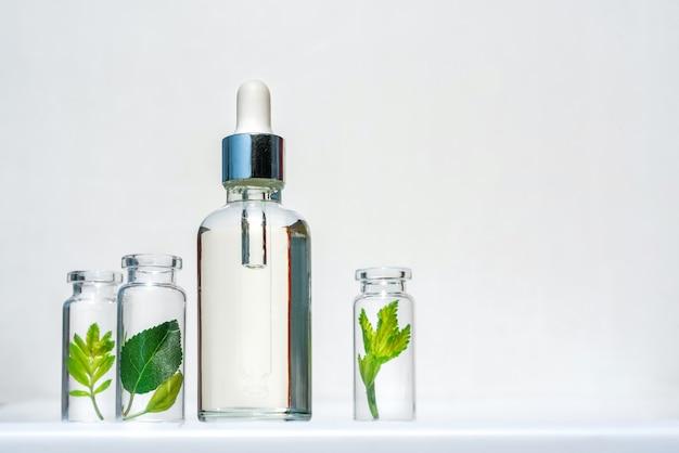 Naturkosmetikprodukt, serum zur pflege und schönheit von haut und haar. homöopathische pflanzenöle