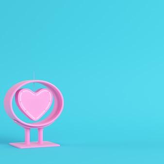 Neon, rosa herzform im rahmen auf hellblauem hintergrund