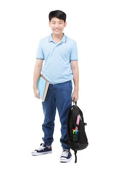 Nettes asiatisches kind mit schulnotizbuch und -rucksack