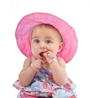 Nettes weibliches kleinkind mit lutscher