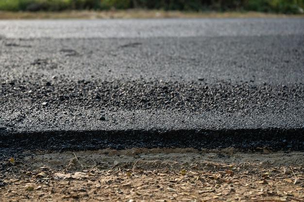 Neue asphalt asphalt textur straße der reparatur auf der beschädigten autobahn