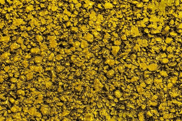 Neuer gelber asphalt. strukturiert, hintergrund. flach liegen. nahansicht.
