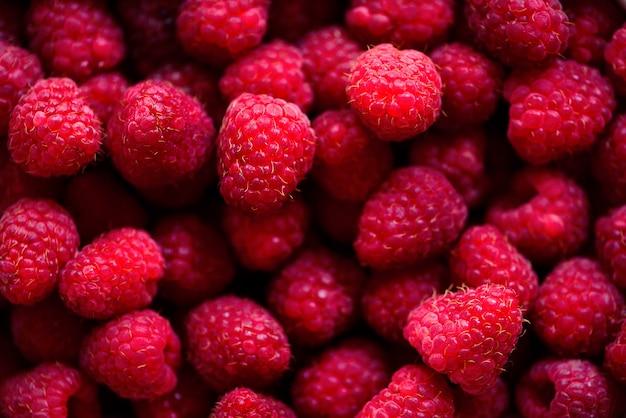 Neuer himbeerhintergrund. sommer, vitamin, vegan, vegetarisches konzept. gesundes essen. makro der beeren