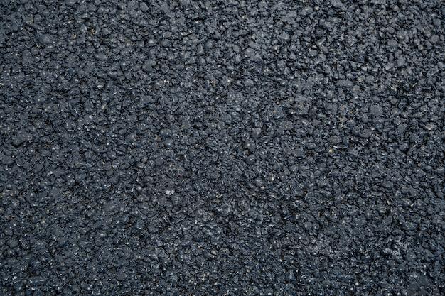 Neuer strukturierter asphalthintergrund flach nah oben