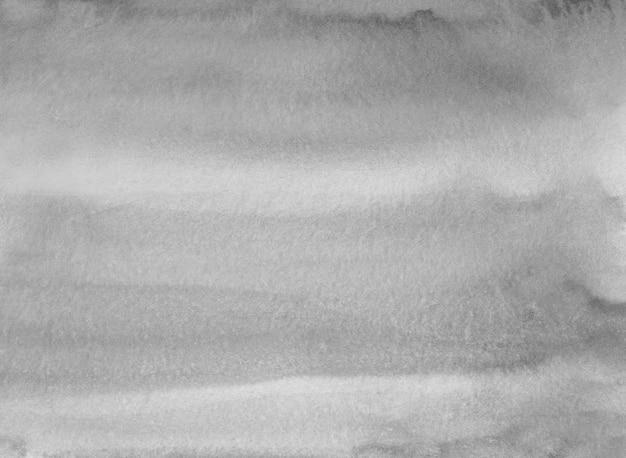 Neutrale graue aquarellflecken auf papierhintergrundbeschaffenheit. monochrome überlagerung. abstrakte aquarellschwarzweiss-moderne malerei.