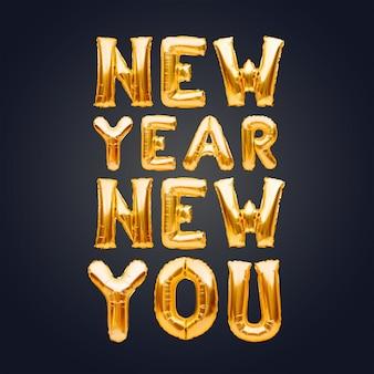 New year new you satz aus goldenen aufblasbaren luftballons auf dunklem hintergrund, neues zielkonzept.