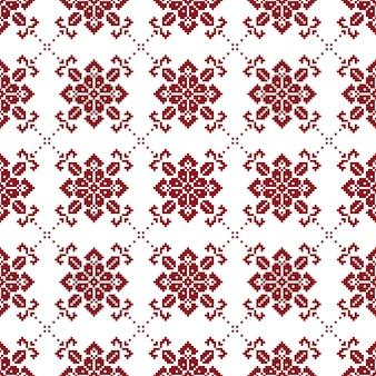 Norwegisches nahtloses weihnachtsmuster mit den roten und weißen farben