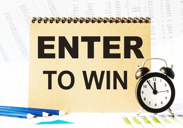 Notizbuch, bleistifte und uhren auf dem tisch mit finanzpapieren. ihr text enter to win