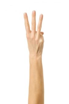 Nummer drei. frauenhand gestikuliert lokalisiert auf weiß