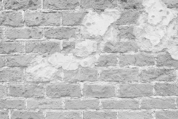 Oberfläche der weinleseweißbacksteinmauer