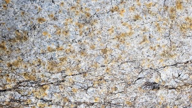 Oberfläche des marmors mit brauner tönung. details der sandsteinstruktur, nahaufnahme der felsoberfläche mit vignette an der abdeckung und hellem fleck in der mitte, idee für hintergrund oder hintergrund.
