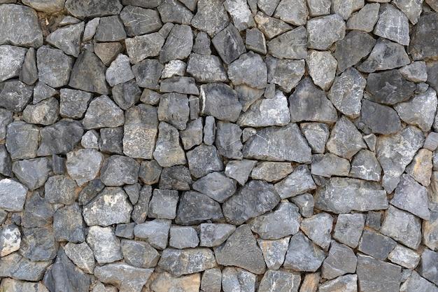 Oberfläche des natursteinmauerhintergrundes
