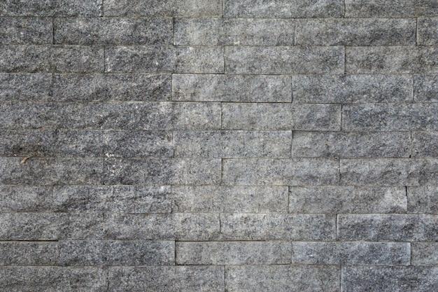 Oberfläche des steinmauerhintergrundes