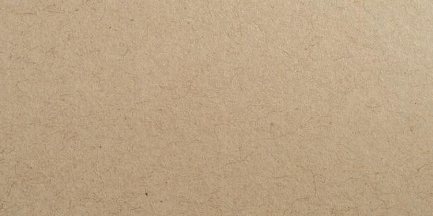 Oberflächenbeschaffenheit und -hintergrund des braunen papiers des panoramas mit kopienraum.