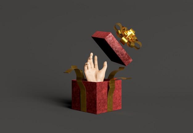 Öffnen sie die geschenkbox mit einer herauskommenden hand